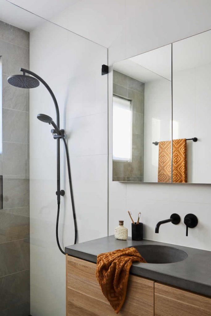 modern ensuite timber and black floating vanity