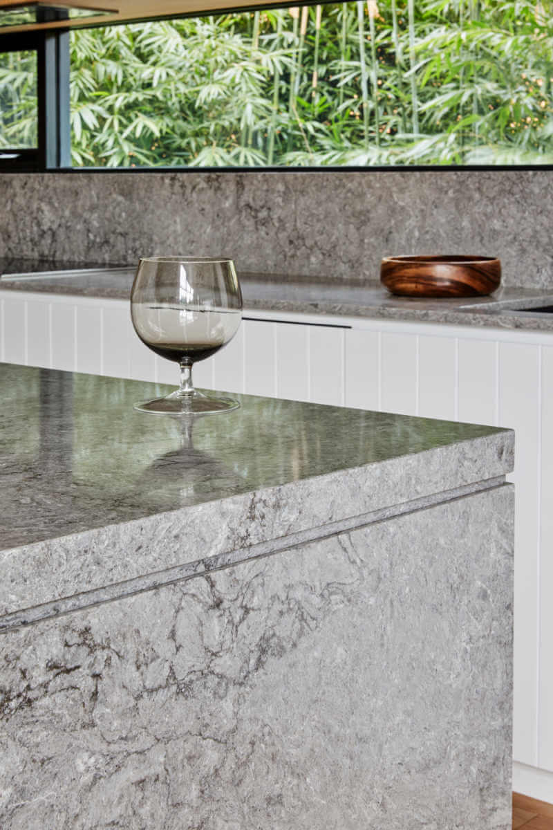 North shore kitchen stone benches wood grain cabinets